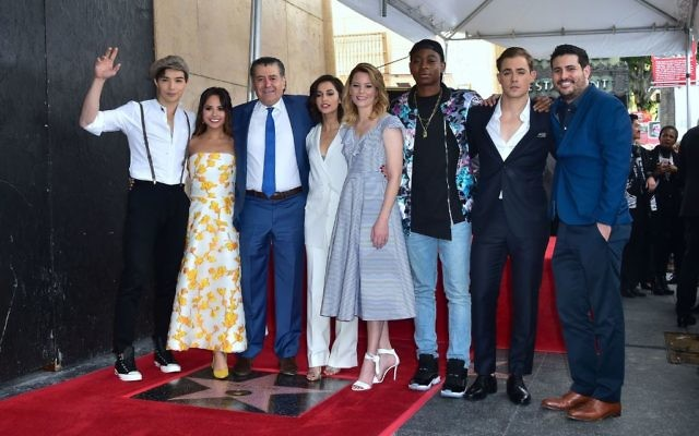 Producer and Power Rangers creator Haim Saban poses with the cast from the Power Rangers movie at his Hollywood Walk of Fame Star ceremony on March 22, 2017 in Hollywood, California, where he received the 2,605th Star in the category of Television. Getty Images