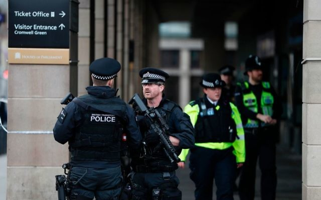 Armed police secure the area across the road from the Palace of Westminster housing the Houses of Parliament in central London on March 23, 2017  after the March 22 terror attack at the British parliament. Getty Images