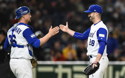 Catcher Ryan Lavarnway, left, and pitcher Josh Zeid of Team Israel celebrating after defeating Cuba in the World Baseball Classic at the Tokyo Dome, March 12, 2017. (Matt Roberts/Getty Images)