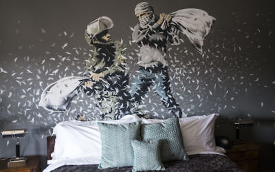 A general view inside street artist Banksy's newly opened Walled Off Hotel in the Israeli occupied West Bank town of Bethlehem on March 4, 2017 in Bethlehem, West Bank. Anonymous British street artist Banksy launched a hotel in the West Bank and next to the security barrier. The rooms of the hotel are also filled with the artist's work, much of which being about the conflict. The owners say it will be a functioning hotel along with being part art gallery and part political statement. Getty Images