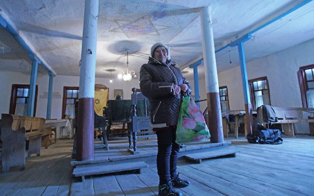 Bronia Feldman visiting the synagogue of Bershad, Ukraine, March 9, 2017. (Cnaan Liphshiz)