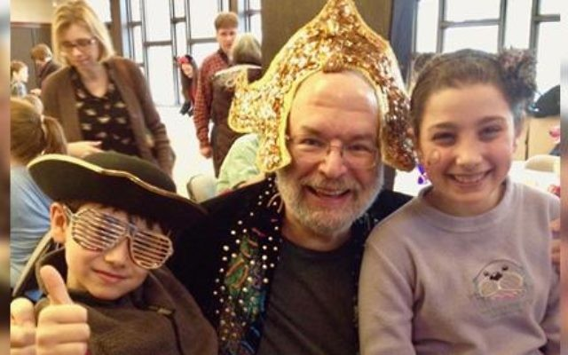 Rabbi Howard Jaffe of Temple Isaiah in Lexington, Mass., is flanked by the purple princess, on the right, and her brother Saul Munn.  Photo courtesy Amalia Munn