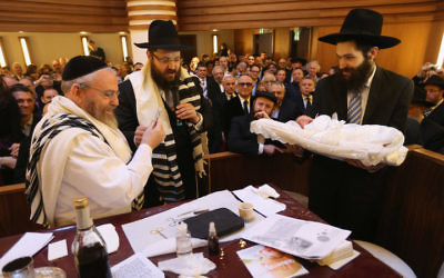 Orthodox Jews at a circumcision at an Orthodox Jewish synagogue in Berlin, Germany. Getty Images