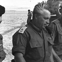 Israeli army's Southern Command General Ariel Sharon, C, arrives by helicopter with Generals Haim Bar-Lev, L, and Yishayahu Gavish, R, at an army base just days before the June 5 start of the Six-Day War, June 1, 1967 in the Negev Desert in southern Israel. David Rubinger/GPO via Getty Images