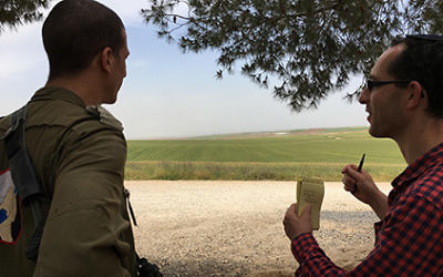 Hamas softening terrorist image? The author, right, with Israeli army captain looking out across the Israeli border into Gaza.