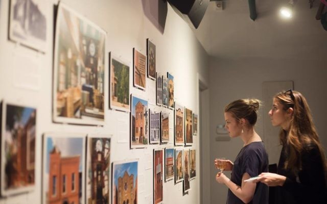 """Museum visitors view the exhibit """"Traces of the Past,"""" a photos of Montreal's disappearing downtown synagogues. Nasuna Stuart-Ulin photo via Facebook"""