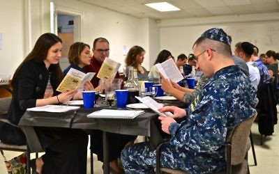 About two dozen members of the U.S. Navy, and one Army family, attended the first-night seder this week at Norfolk's Uriah P. Levy Chapel.  Photos by Chaplain Vinson Miller