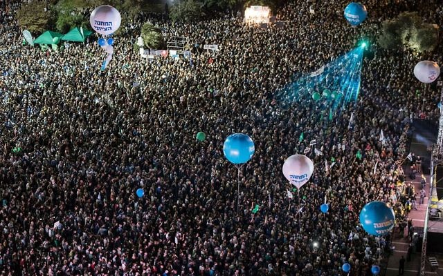 Israelis attend a rally to mark the 21th anniversary of the assassination of former Israeli prime minister Yitzhak Rabin at the Tel Aviv plaza where he was shot in the Mediterranean coastal city of Tel Aviv on November 5, 2016. Getty Images