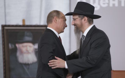 Russian President Vladimir Putin, left, is greeted by Russia's Chief Rabbi Berel Lazar in Moscow, June 13, 2013. (Alexander Zemlianichenko/AP Images)