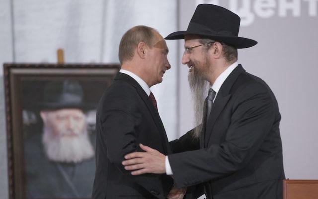 Russian President Vladimir Putin, left, is greeted by Russia's Chief Rabbi Berel Lazar in Moscow, June 13, 2013. (Alexander Zemlianichenko/AP Images)