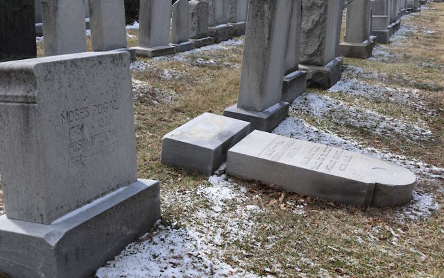 Vandalized gravestones at the Stone Road or Waad Hakolel Cemetery in Rochester, New York, March 3, 2017. JTA