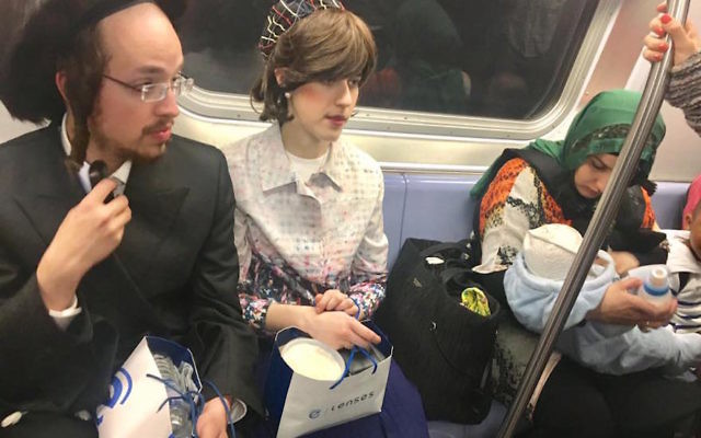 The photo of a Hasidic Jewish couple sitting next to a Muslim woman nursing a baby on the New York City subway that has gone viral. JTA