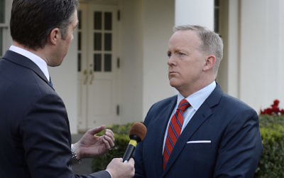 Sean Spicer in an interview at the White House apologizing for comments he made suggesting that President Bashar Assad of Syria was worse than Hitler, April 11, 2017. (Olivier Douliery/Pool/Getty Images)
