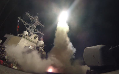 The USS Porter firing a Tomahawk missile at a Syrian military airfield in the Mediterranean Sea, April 7, 2017. (Ford Williams/U.S. Navy via Getty Images)