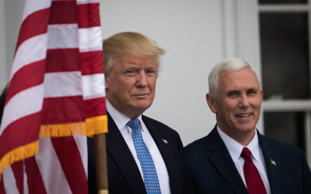 Donald Trump and Mike Pence at Trump International Golf Club in Bedminster Township, N.J., Nov. 20, 2016. (Drew Angerer/Getty Images)