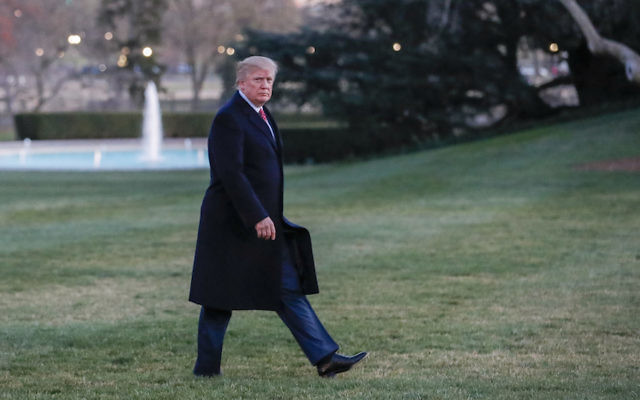 President Donald Trump walking across the South Lawn toward the White House, March 5, 2017. (Erik S. Lesser-Pool/Getty Images)