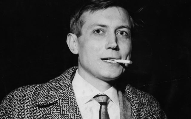 Russian poet Yevgeny Yevtushenko smoking a cigarette as he arrives in Britain at London Airport, April 28th 1962. JTA