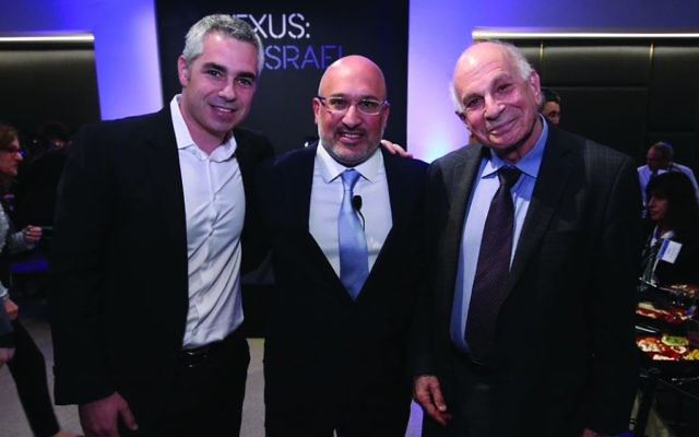 Nobel laureate Daniel Kahneman, right, delivered a keynote address at Nexus:Israel conference. He was joined by Avner Mendelson, left, president & CEO Leumi USA and Aryeh Bourkoff, founder and CEO of Lion Tree. Sean Smith/Mike Cohen Photography Credit