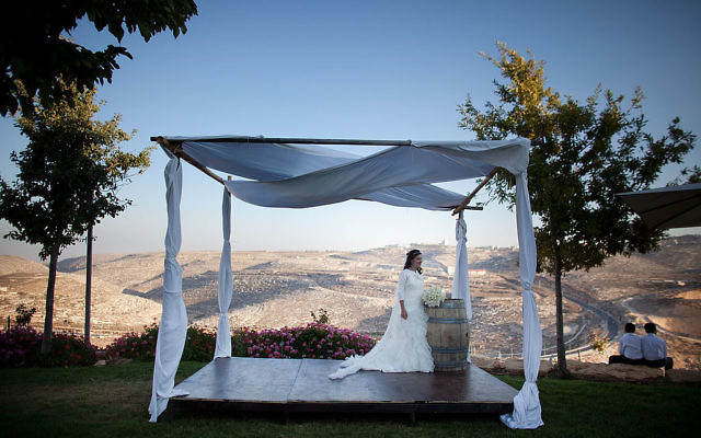 A bride poses for her wedding photos ahead of her wedding in Israel. Getty Images