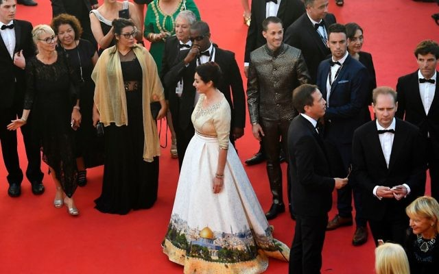 Israeli Culture Minister Miri Regev wearing a dress featuring the old city of Jerusalem arrives on May 17, 2017 for the screening of the film 'Ismael's Ghosts' (Les Fantomes d'Ismael) during the opening ceremony of the 70th edition of the Cannes Film Festival in Cannes, southern France.   Getty Images