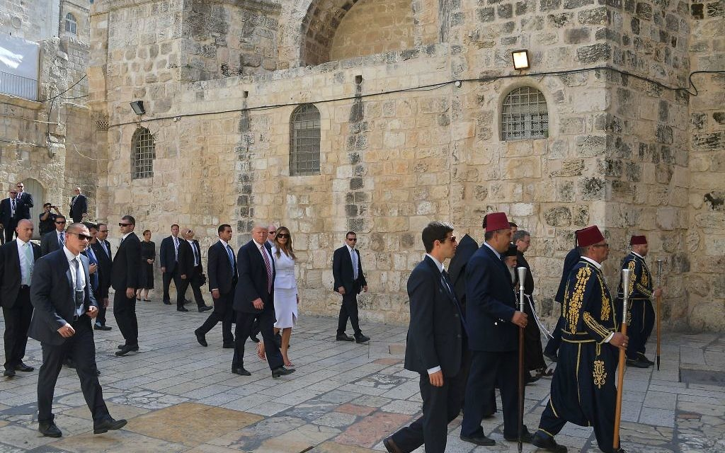 US President Donald Trump (C) and  First Lady Melania Trump visit the Church of the Holy Sepulchre in Jerusalems Old City on May 22, 2017. / AFP PHOTO / MANDEL NGAN        (Photo credit should read MANDEL NGAN/AFP/Getty Images)