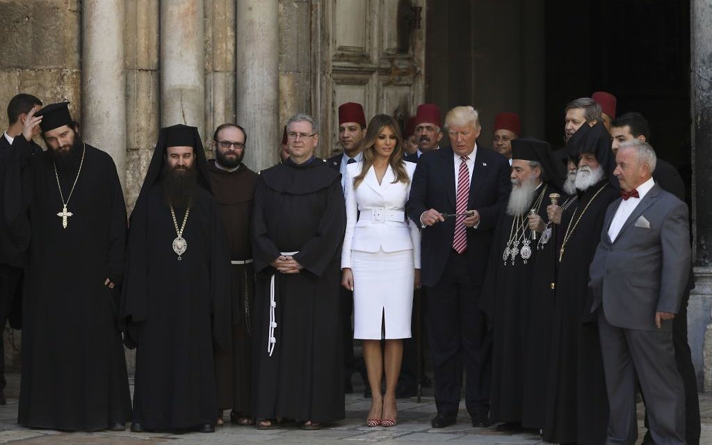 US President Donald Trump (C-R) and  First Lady Melania Trump (C-L) visit the Church of the Holy Sepulchre in Jerusalems Old City on May 22, 2017. / AFP PHOTO / POOL / RONEN ZVULUN        (Photo credit should read RONEN ZVULUN/AFP/Getty Images)