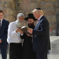 US President Donald Trump  listens to Rabbi Shmuel Rabinovitch (C) during a visit to the Western Wall, the holiest site where Jews can pray, in Jerusalems Old City on May 22, 2017. On the left, Trump's son-in-law and senior advisor Jared Kushner.  / AFP PHOTO / MANDEL NGAN        (Photo credit should read MANDEL NGAN/AFP/Getty Images)