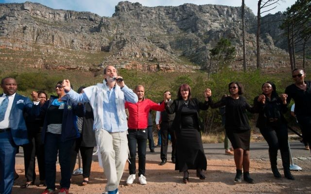 A Jewish rabbi leads a traditional dance during a prayer for rain at the foot of Table Mountain, on May 25, 2017, in Cape Town. The mayor of Cape Town, Patricia de Lille, has called on religious leaders from various denominations to come together to pray for rain in the drought-stricken province, where stock of water in the area's dams have only about 10% of useable water left. Getty Images