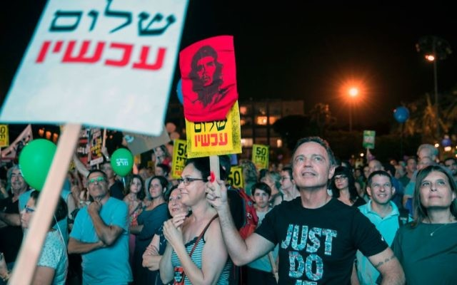 """Israeli left-wing supporters gather at Rabin Square in the Israeli coastal city of Tel Aviv for a mass demonstration against 50 years of occupation titled """"Two States - One Hope"""", on May 27, 2017. Getty Images"""