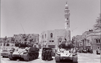 File picture dated 10 June 1967 shows two Israeli US-made Super-Sherman tanks patroling in East Jerusalem. After weeks of belligerency and brinkmanship by regional and international players, Israel launched what it called a preemptive strike in the early hours of June 5, 1967 and quickly faced off Egypt, Jordan and Syria. Getty Images