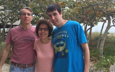 Sam Busis with his parents. Courtesy of Ramah