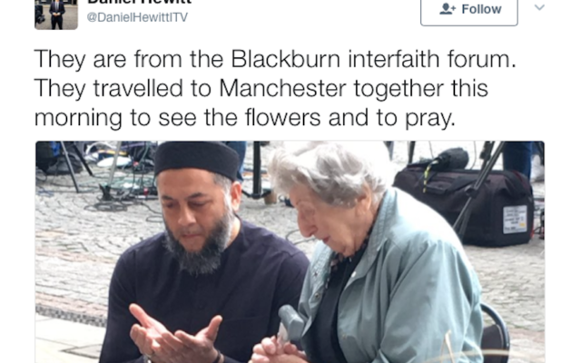 A Muslim man and a Jewish woman mourning the victims of the Manchester terror attack, May 24, 2017. (Screenshot from Twitter)