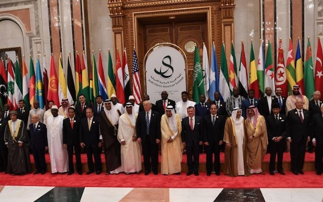 In this handout photo provided by the Palestinian Press Office, U.S. President Donald Trump joins Saudi Arabia's King Salman bin Abdulaziz al-Saud and other Arab leaders at a summit meeting May 21, 2017 in Riyadh, Saudi Arabia. JTA