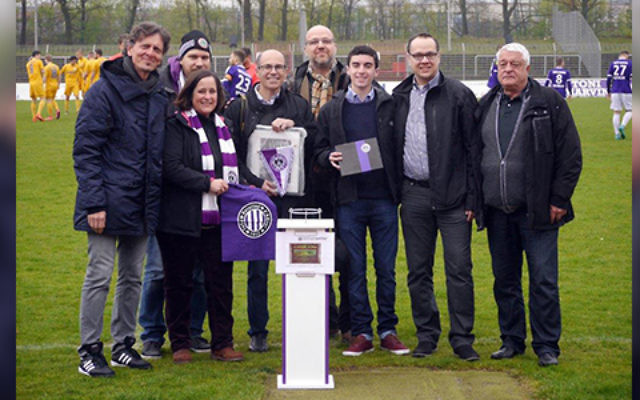 Photo Caption: Benjamin Marks and his father being honored on the TeBe pitch in Berlin. Photo courtesy of Benjamin Marks.