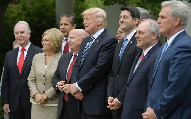 President Donald Trump, center, with House Speaker Paul Ryan, third from right, and other Republican House leaders in the Rose Garden of the White House, May 4, 2017. (Mandel Ngan/AFP/Getty Images)