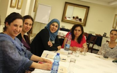 """A Center for Educational Technology session for Jerusalem school principals. """"These are not the usual suspects from the left,"""" says Myriam Darmoni Charbit, a CET official. """"They are not used to sitting in the dialogue circle."""" Photos courtesy of CET"""