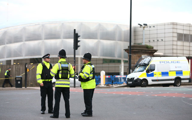 Police officers standing in front of the Manchester Arena in England, where a suspected suicide bomber killed at least 22 people, May 23, 2017. (Dave Thompson/Getty Images)