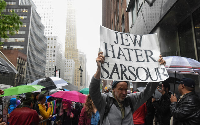 Protest demonstrate outside a speaking engagement by Linda Sarsour in New York City, May 25, 2017. JTA