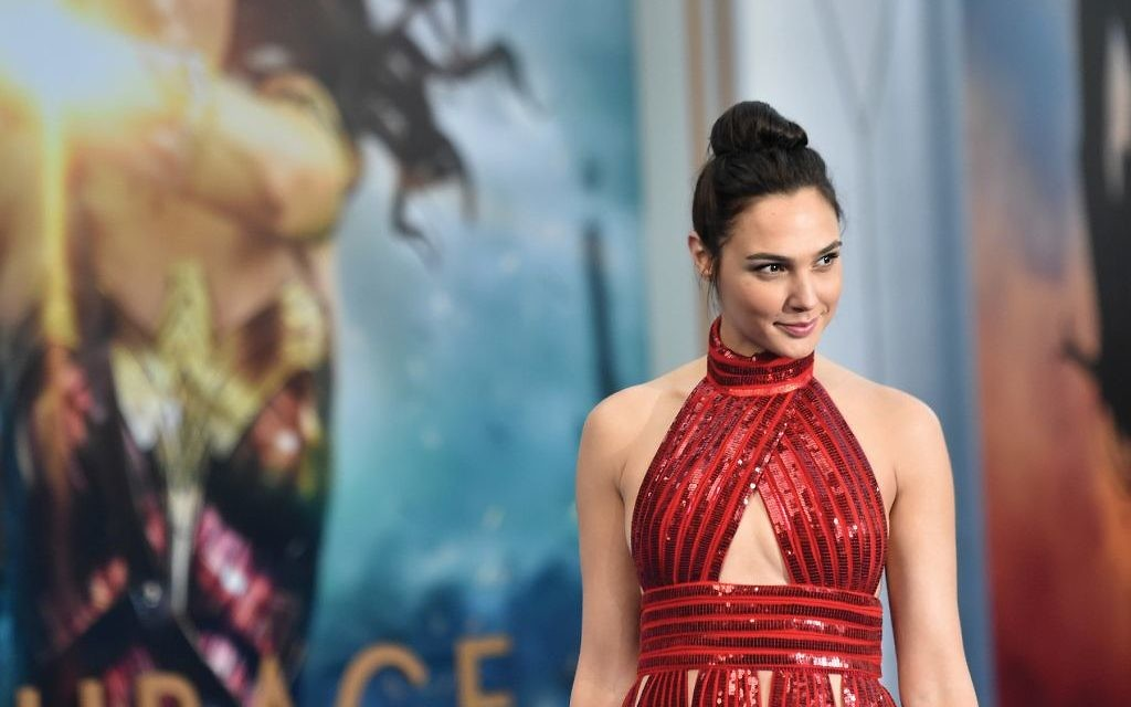 "Gal Gadot, with her Wonder Woman persona behind her, at the film's opening in Hollywood. She's ""a gift from heaven,"" says an Israeli-American communal leader. Getty Images"