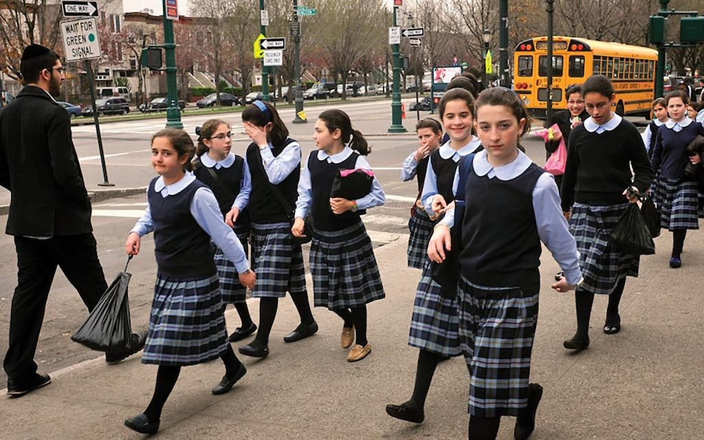 "Young charedi Orthodox girls in Crown Heights. Parents should ""show our girls how to dress with finesse,"" Bnos Menachem school director says. Serge Attal/Flash90"