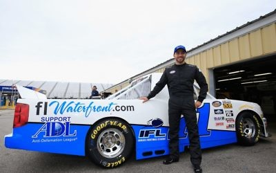 Alon Day at a race last year in Loudon, N.H., when he had an ADL sticker on his car. Chris Trotman/NASCAR via Getty Images