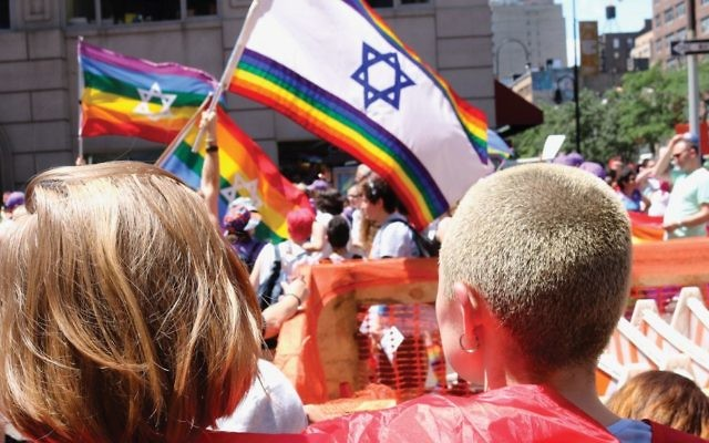 The scene Sunday at the New York Pride parade, where the modified Israeli/Pride flag carried a symbolic message. Harry D. Wall
