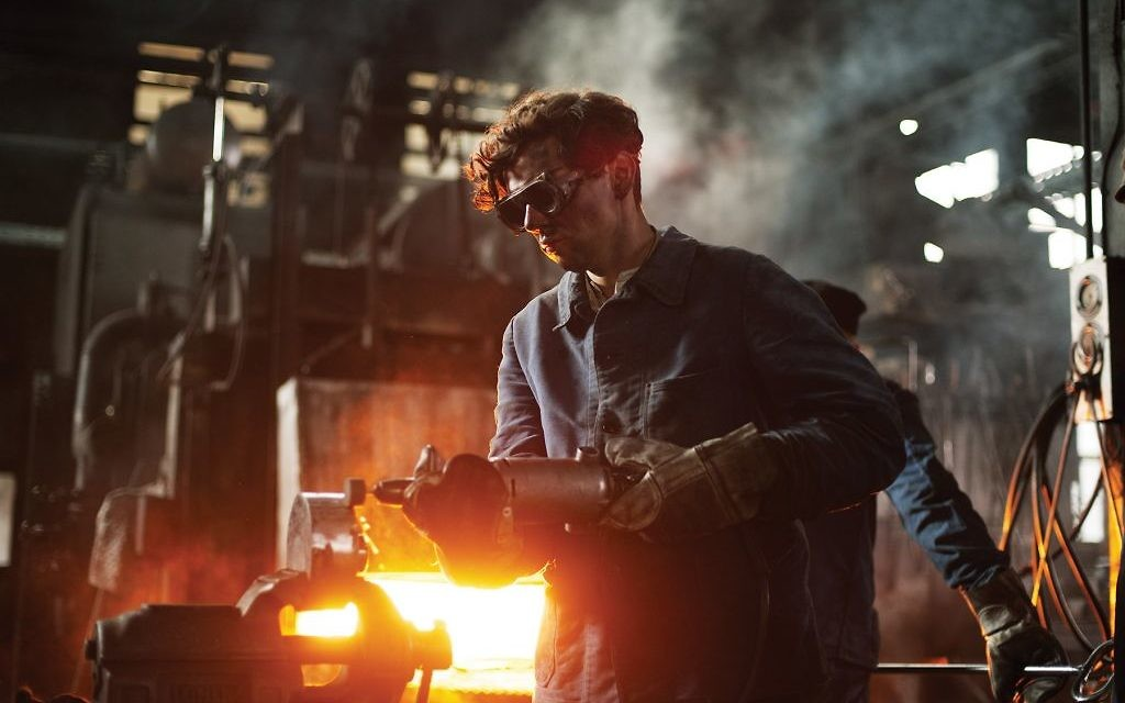 """Christian Friedel in an armaments factory in a scene from """"13 Minutes."""" Sony Pictures Classics"""