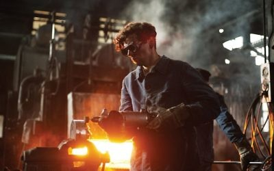 "Christian Friedel in an armaments factory in a scene from ""13 Minutes."" Sony Pictures Classics"