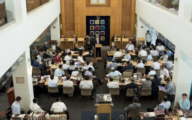 While approximately 75 percent of Orthodox rabbis over 50 are Democrats, about 60 percent of Orthodox rabbis under 50 are Republicans. Pictured above is the Yeshiva University study hall. Via yu.edu