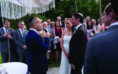 Rabbi Lau-Lavie officiating at the wedding of Ben and Elana. Courtesy of Christopher Duggan
