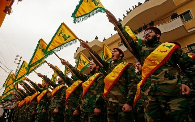 Fighters of the Shiite Hezbollah movement attend the funeral of a comrade who died in combat in Syria in March 2017. Two men were arrested in Hezbollah plot in the US yesterday. Getty Images