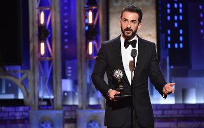 "Michael Aronov accepts the award for Best Performance by an Actor in a Featured Role in a Play for ""Oslo"" onstage during the 2017 Tony Awards at Radio City Music Hall on June 11, 2017 in New York City. Getty Images"