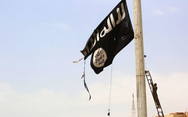 An Islamic State flag flying in the Syrian town of Tabqa, April 30, 2017. (Souleiman/AFP/Getty Images)