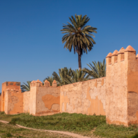 """The walls of Medina in Marrakesh. Jews reportedly lived inside, near the royal compound. The red clay of the walls gives the city it's name as the """"red city."""" Courtesy of Richard Nowitz"""